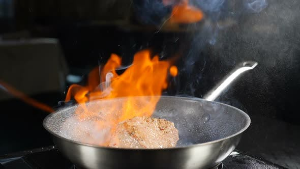 Thumbnail for Cooking and Serving Food in Restaurant. Chef Making Steak Fillet Mignon in Flambe Style on Grill Pan