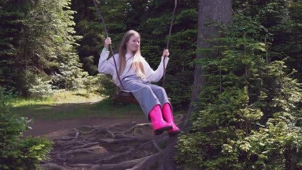 Thumbnail for Girl on Swing in Forest.