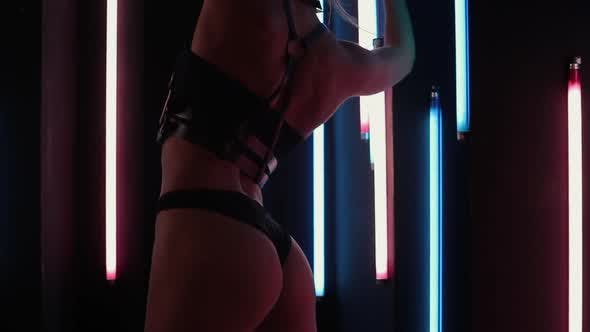 Thumbnail for Female Stripper Dancing in Neon Lights