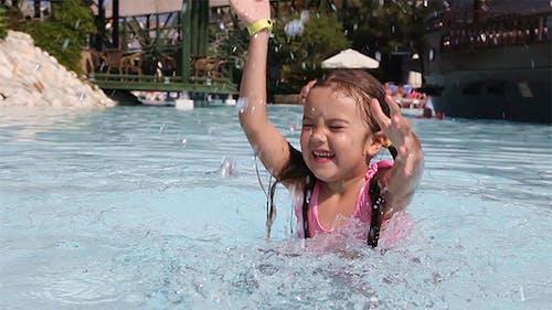 Little Girl Having Fun in a Swimming Pool
