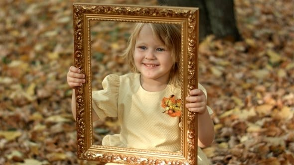 Thumbnail for Girl Posing With Picture In Autumn Park