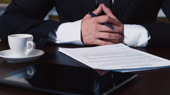 Thumbnail for Businessman Signs a Number Of Document