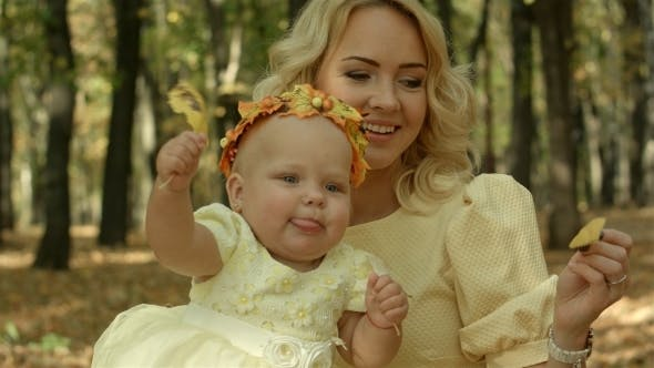 Thumbnail for Happy Young Mother With Daughter In Autumn Park