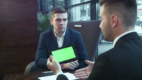 Thumbnail for Dialogue Of Businessmen Using The Touchpad