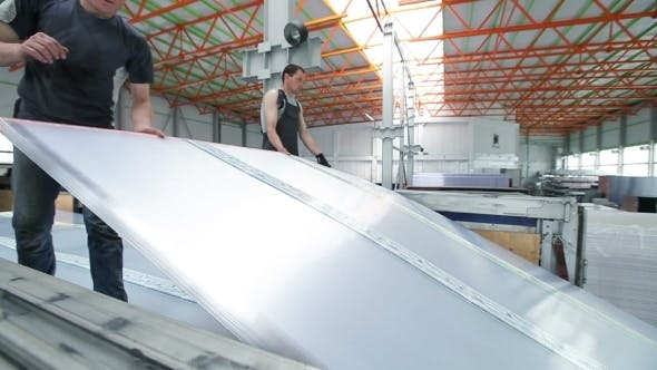 Thumbnail for Workers Loaded Polycarbonate Sheets In The Truck