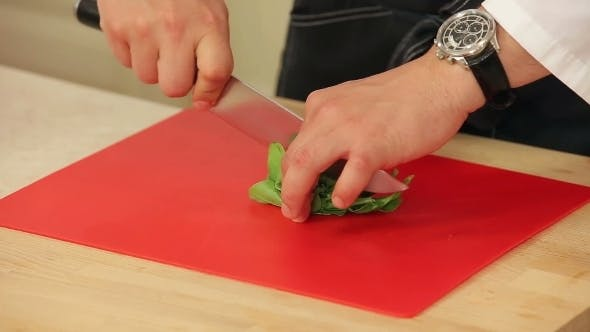 Thumbnail for Chef Cutting Spinach Salad