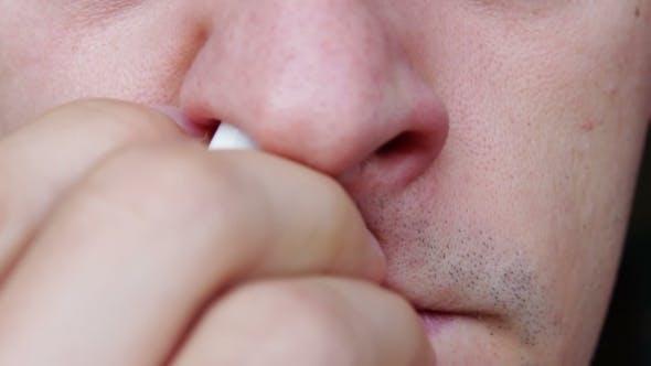 Thumbnail for Man Using Nasal Spray