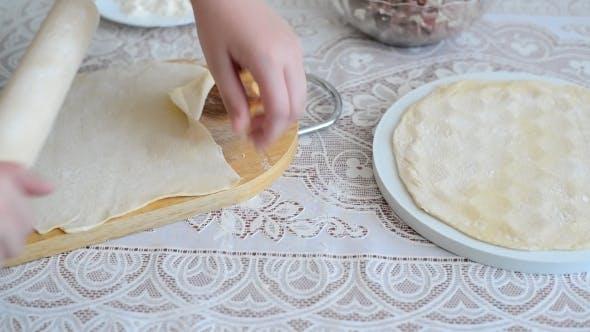 Thumbnail for Children's Hands Unroll a  Dough For Pelmeni