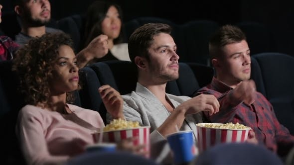Thumbnail for A Group Of People Watching a Movie Showing Emotion