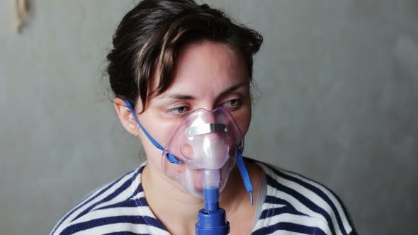 Thumbnail for Woman Wears a Mask For Inhalation, And Conducts