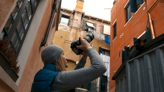 Thumbnail for Female Photographer Taking Pictures Of Old Houses
