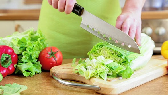 Thumbnail for Woman's Hands Cutting Vegetables