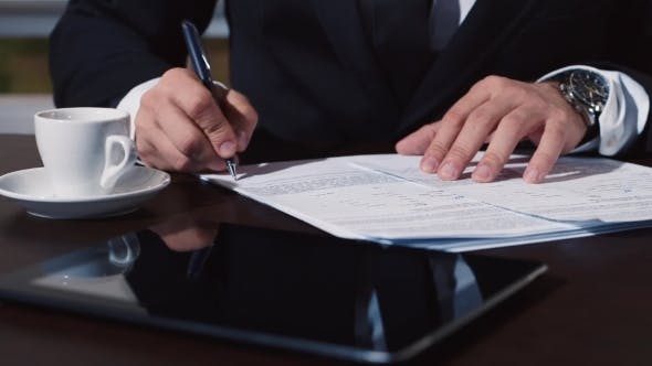 Thumbnail for Man's Hand In a Business Suit Signs Documents