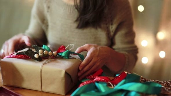 Thumbnail for Women's Hands Wrapping Christmas Gifts At Home