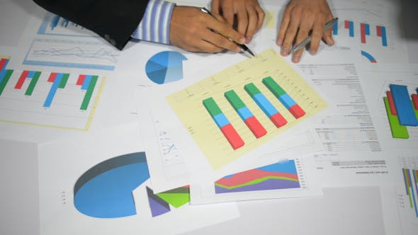 Thumbnail for Businessmen Paper Work in Office