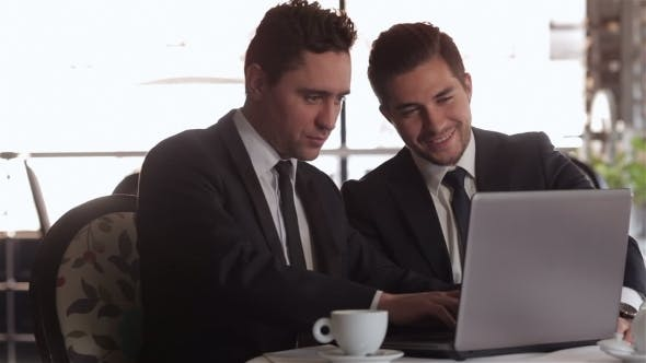 Thumbnail for Businessman Using Laptop At Lunchtime