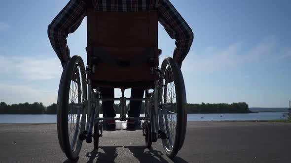 Thumbnail for A Man in a Wheelchair Walks on the Waterfront