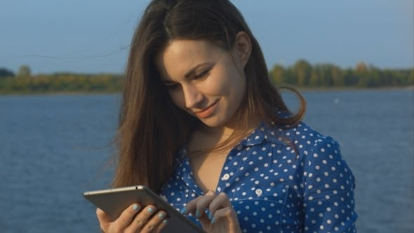 Thumbnail for Woman Outdoor Using Digital Tablet
