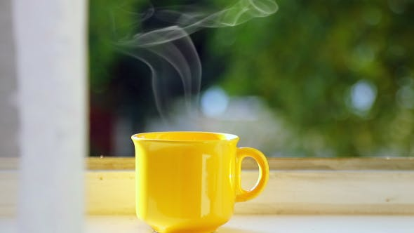 Thumbnail for Yellow Cup of Coffee on the Windowsill