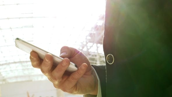 Cover Image for Businessman Chatting On Smartphone