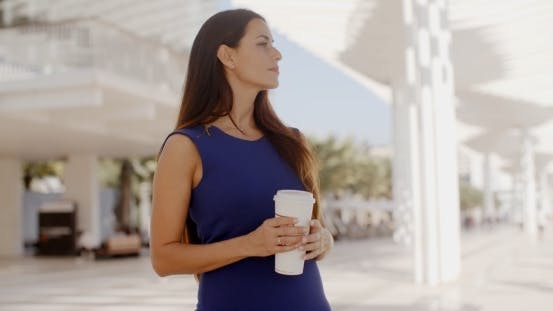 Thumbnail for Attractive Woman Holding a Large Cup Of Coffee