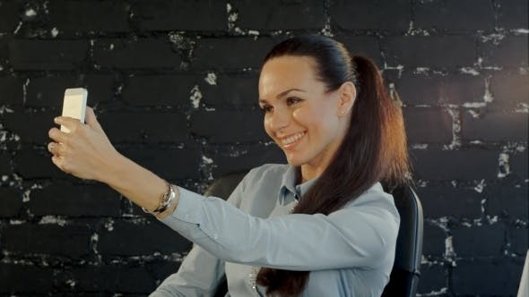 Smiling Businesswoman Making Selfie Photo On