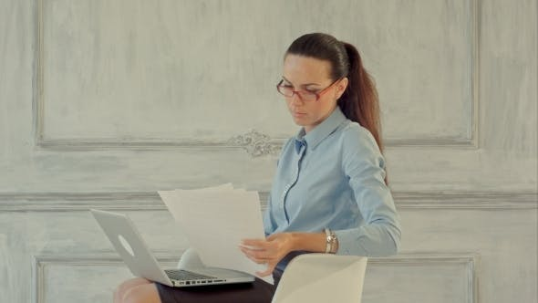 Thumbnail for Attractive Businesswoman Reading Stats And Graphs