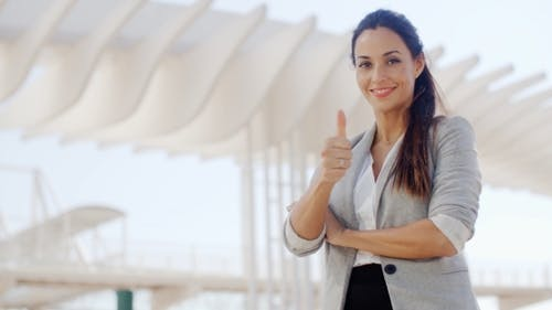 Motivated Young Woman Giving a Thumbs Up