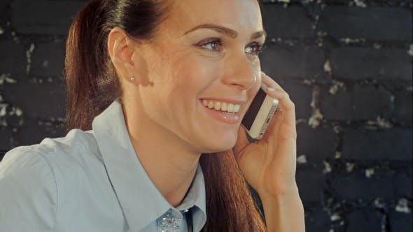 Beautiful Brunette Woman Or Businesswoman Talking