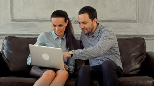 Thumbnail for Businessman And Business Woman Sitting At Office