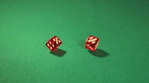 Two Dice On A Green Background