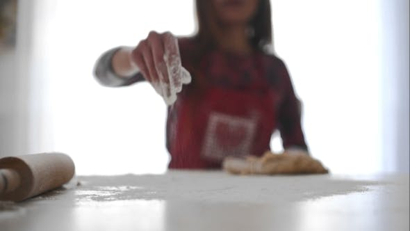 Thumbnail for Housewife Distributes Flour On The Table