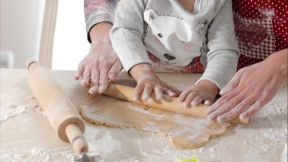 Thumbnail for Housewife With Her Daughter Preparing Gingerbread