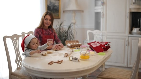 Cover Image for Housewife With Her Daughter Preparing Gingerbread