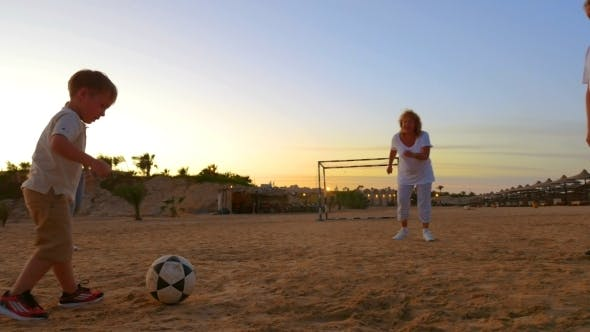 Thumbnail for United Family Playing Beach Football