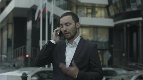 Thumbnail for Russian Businessman Answering Call By Phone