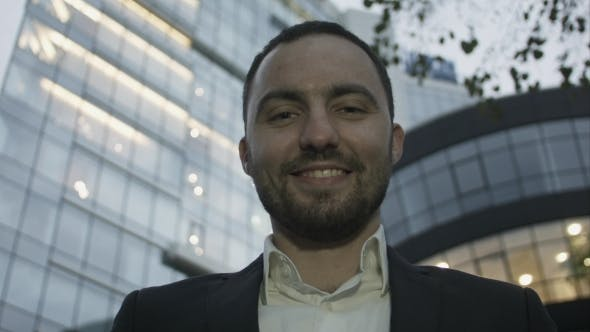 Thumbnail for Portrait Of Young Business Man On Office Building