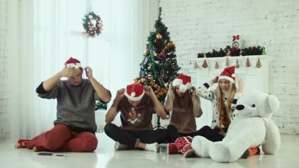 Thumbnail for Group Of Teen Friends Wears Santa Hats And Hugging