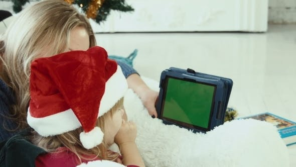 Thumbnail for Mom Reads a Christmas Story With Touchpad With