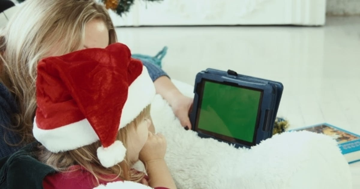 Mom Reads a Christmas Story With Touchpad With