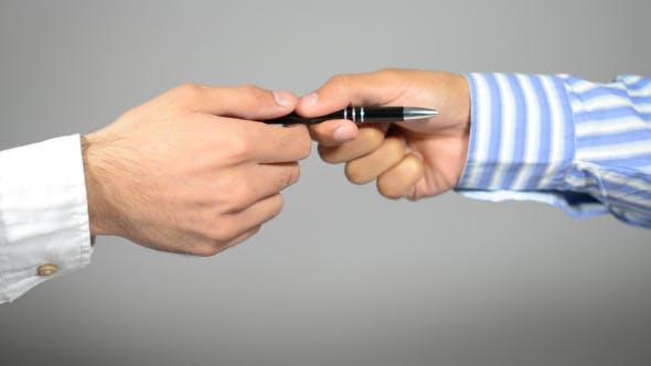 Hand Giving Pen