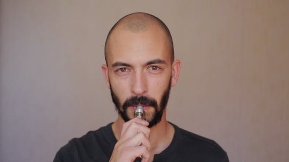 Cover Image for A Bald Man With a Beard Smokes Electronic