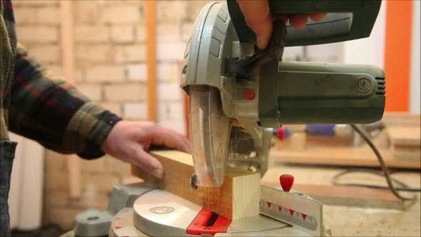 Thumbnail for Carpenter Cuts Wooden Blocks Machine Tool