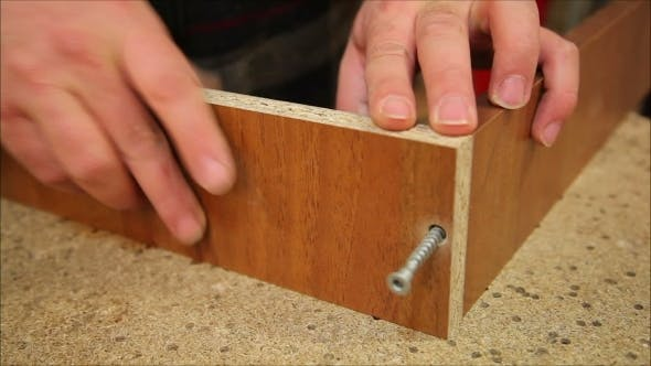 Thumbnail for Worker Processes a Wooden Board