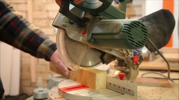 Thumbnail for Carpenter Cuts Wooden Blocks Machine Tool