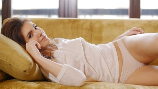 Thumbnail for Sexy Cute Girl Relaxing On Couch