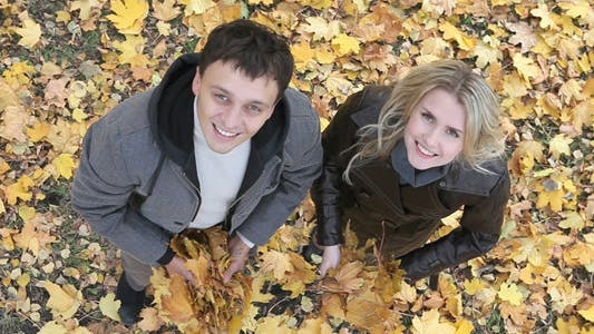Thumbnail for Couple throwing leaves
