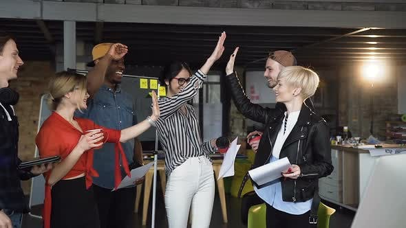 Thumbnail for Diverse Creative Business People Combine their Efforts Giving Each Other High Five