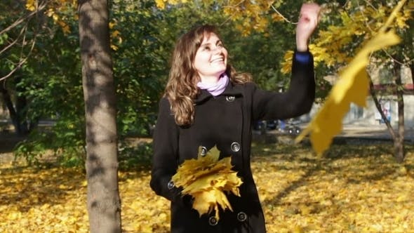 Thumbnail for Happy Girl In Autumn Park Throws Yellow Fallen