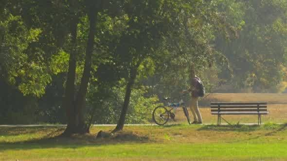 Thumbnail for Man With Backpack is Standing at The Bench